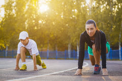 Runners in start position. Family Runners in start position Royalty Free Stock Photo