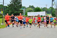 Runners Starting Out. Participants of the Dominic Days 5K Race in Brookfield, Wisconsin begin their race, as the starting gun goes off Stock Photography