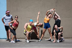 Runners stretching their bodies. Stock Images