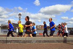 Runners in the sunshine along the river Stock Photo