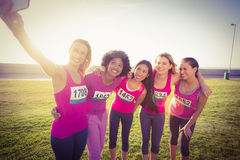 Runners supporting breast cancer marathon and taking selfies Stock Image