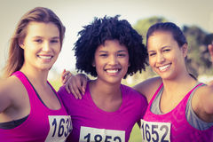 Runners supporting breast cancer marathon and taking selfies. In parkland Royalty Free Stock Images