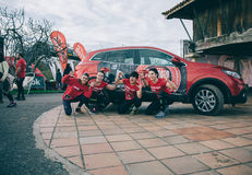 Runners team posing in front of car before the race Royalty Free Stock Image