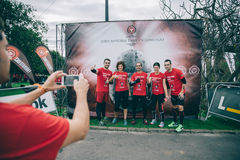 Runners team posing in front of official banner before the race Royalty Free Stock Photography