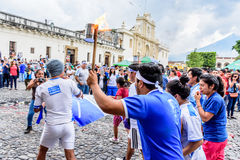 Runners with torch, Independence Day, Antigua, Guatemala Stock Image