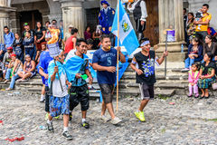 Runners with torches & flags, Independence Day, Antigua, Guatema Royalty Free Stock Image