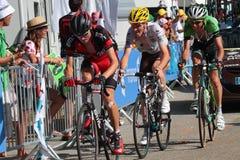 Runners of Tour de France. CHAMROUSSE, FRANCE, JULY 18, 2014 : Three runners in Chamrousse stage of Tour de France. Tour de France is the biggest professional Stock Images