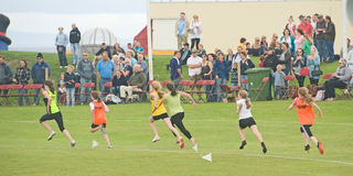 Runners in a track event at Nairn. Royalty Free Stock Images