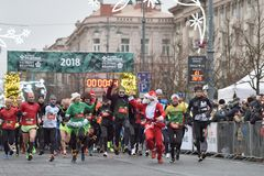 Runners on traditional Vilnius Christmas race royalty free stock photography
