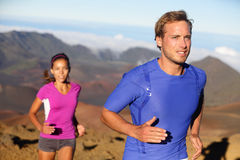 Runners trail running athletes young couple. Runners trail running athletes. Young fitness runner couple training trail running cross-country run for marathon stock photography