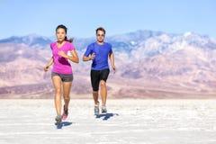 Runners trail running on dry desert landscape royalty free stock images
