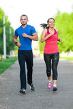 Runners training outdoors working out. City Stock Photo