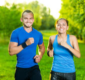 Runners training outdoors working out. City Royalty Free Stock Photo
