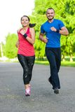 Runners training outdoors working out. City Stock Photos