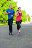 Runners training outdoors working out. City running couple jogging outside. Royalty Free Stock Photography