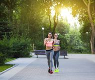 Runners training outdoors working out in the park. Runners training outdoors working out in the city park stock photo