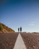 Runners training together on the road Stock Image
