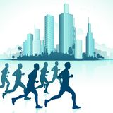 Runners in Urban Backdrop Stock Image