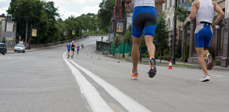 Runners in an urban road race Stock Image