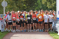 Runners waiting to start Stock Photo