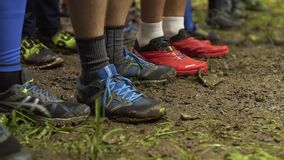 The runners warm up before the start of the race stock footage