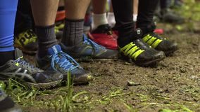 The runners warm up before the start of the race stock video footage