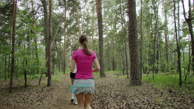 Runners working out. Group of young people trail running in a forest. Runners working out in beautiful nature stock video