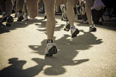 Runnig race. Photo of a running race showing only feet and legs.  Filted dark Royalty Free Stock Photography