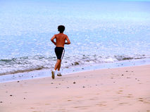 Running. In the beach Royalty Free Stock Image