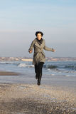 Running. The girl runs along the Black Sea Stock Photography