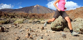 Running. In spectacular volcano landscape on Teide, Tenerife. Woman in pink top Stock Image
