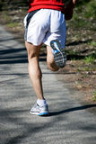 Running. Feet and body of a running man Royalty Free Stock Photos