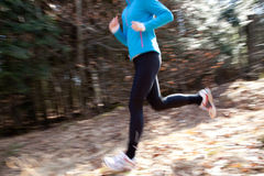 Running. A young woman running through the woods Royalty Free Stock Photo