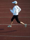 Running. Woman running on the track stock photos