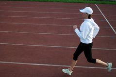 Running. Woman running on the track Royalty Free Stock Image