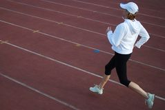 Running. Woman running on the track royalty free stock photo