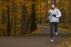 Running. Women running in the autumn forest, motion blur Stock Photography