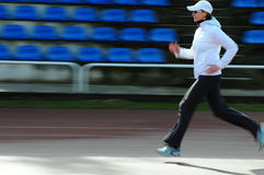 Running. Woman on the track stock photography