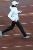 Running. Woman on the track Stock Images