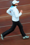 Running. Woman running on the track, intentional, motion blur royalty free stock photos
