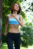 Running. Slim young girl outdoors royalty free stock photo