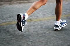 Running. Feet of a running woman
