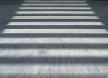Running escape forward across crosswalk traffic signs on asphalt street, closeup blurred motion background. Concept about panic feel run away when faced with stock photo