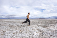 Running across a white desert Stock Photos