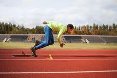 Running african man at stadium Stock Photo