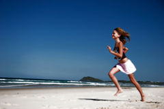 Running along beach. Female running along beach Stock Image