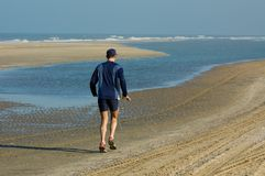 Running along the beach Stock Photo