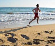 Running along the beach. Running along the beautiful sandy Kaiafas beach, Greece royalty free stock photo