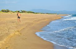 Running along the beach. Running along the beautiful sandy Kaiafas beach, Greece royalty free stock photography