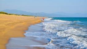 Running along the beach. Running along the beautiful sandy Kaiafas beach, Greece stock photography